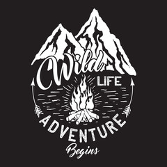 Wildlife inscription with mountains and campfire.