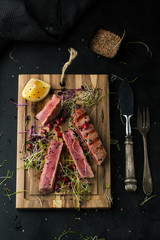 Grilled tuna with spices, sauce and sesame seeds