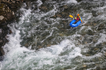 Evan Howard, an avid Explorer and adventurer, navigates a white water section of the Chehalis River on a packraft.