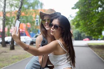 Happy tourists girl friends taking selfie photos