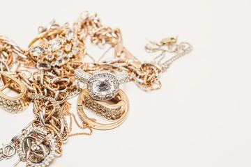 Beautiful golden jewelry. Many fashionable women's jewelry. Macro shot.