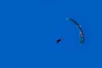 Parachuting Skydiving Flying Through the Blue Sky