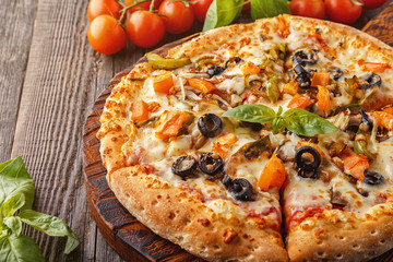 Vegetarian pizza with mozzarella cheese, tomatoes, champignons.