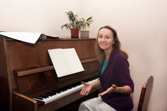 woman teacher playing the piano
