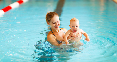 Mother and baby swim  in pool