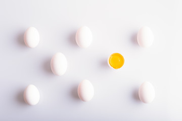 White eggs in a rows on white background