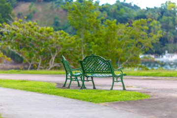 empty metal green benches in the Park