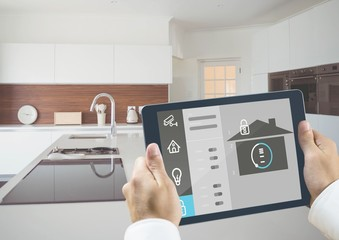 Man holding a digital tablet with home security concept