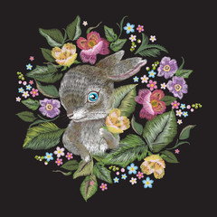 Embroidery colorful trend floral pattern with rabbit. Vector traditional folk roses bouquet and bunny on black background for design.