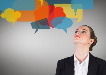 Businesswoman with speech bubble against grey background
