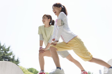Two young women stretching