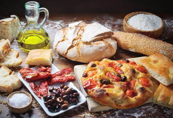 Focaccia with cherry tomatoes and olives, bread, white focaccia, dried tomatoes and olives