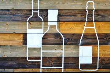 Bottles on wood plate