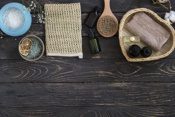 Spa beauty treatment products top view on wooden background. Copy space