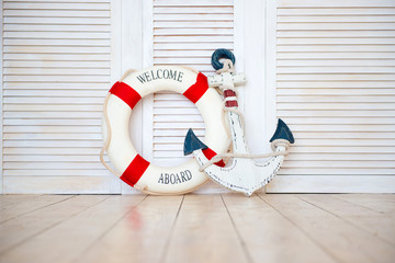 Decor in the style of sea travel, Anchor and lifebuoy, lantern