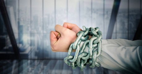 Businessman hands bound in chains