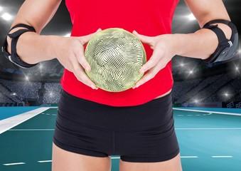 Mid section of woman holding handball at handball court
