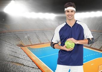 Portrait of handball player holding ball in stadium