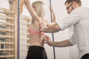 Man hysiotherapist, physical therapy, back diagnosis woman
