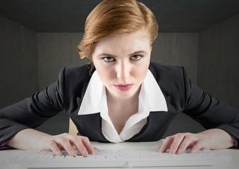 Businesswoman using keyboard on desk
