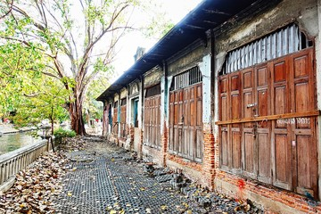 Old vintage wood door wood texture Old brick wall  Bicycle tourists Bicycle touring attractions Old house