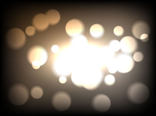 Brown bokeh background. Dark brown defocused light, flickering lights.