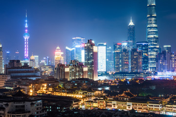illuminated cityscape at night in financial district of China.