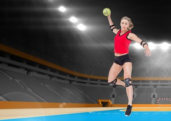 Female athlete playing handball in stadium