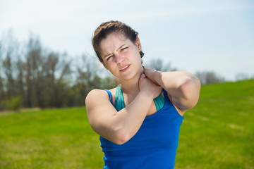 Young woman pain with neck injury at exercise .