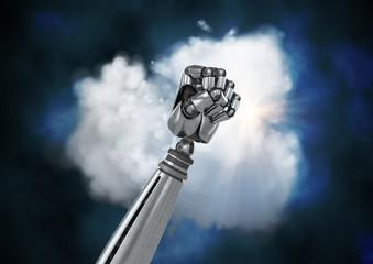 Metal robotic fist against cloud