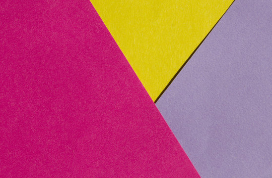 Bright yellow, pink and purple paper texture background diagonal