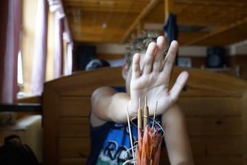 Boy hiding his face with hand. Slovakia