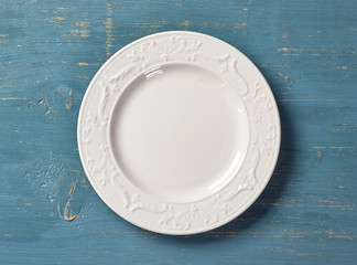 white plate on blue wooden table