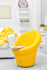 Modern living room with yellow armchair