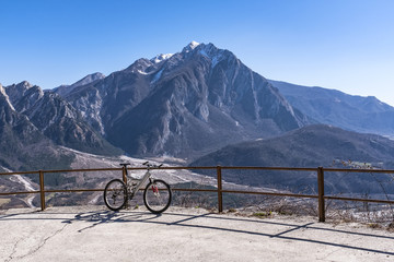 Mountainbike in front of Monte Chiampon