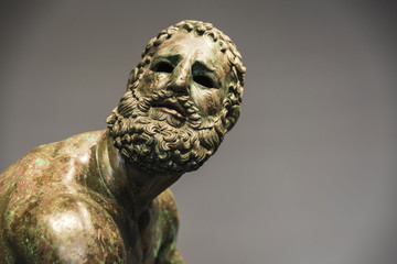 Roman bust or statue made with bronze of a human face