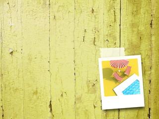 Single photo illustration on yellow wooden background