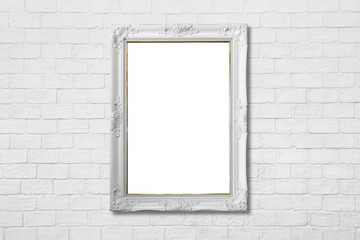 white frame on white brick wall