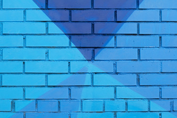 Colorful (blue) painted brick wall as background, texture