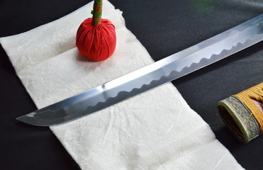 Katana Japanese sword blade and scabbard with red compress for cleaning