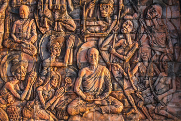 Art on the stone about buddha story on temple wall in Thailand