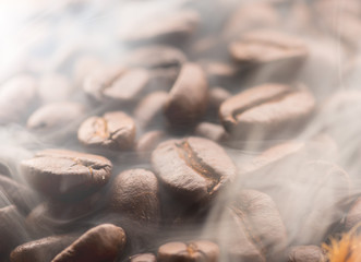 Coffee beans roasting with smoke,Selective focus