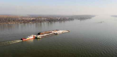 Aerial view on cargo ship sailing on the river Danube