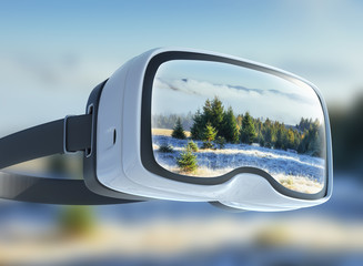 Virtual reality headset, double exposure. Mysterious winter landscape majestic mountains in . Magical  snow covered tree.