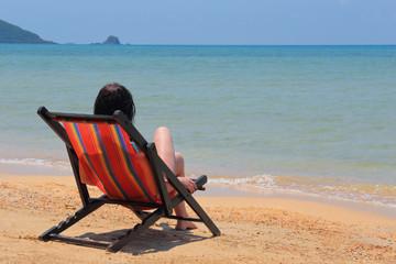 Woman in a deckchair on the beach