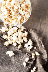 Popcorn on dark background with copyspace, cinema, movies and entertainment concept .