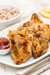 grilled chicken with sauce on dish