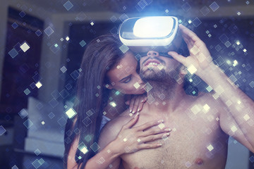 Young couple foreplay with virtual reality headset and blue glowing tiles