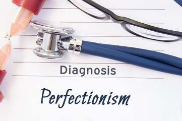 Diagnosis Perfectionism. Psychiatric diagnosis Perfectionism is written on paper, on which lay stethoscope and hourglass for measuring time to research. Concept photo for psychiatry or psychology
