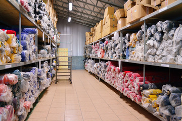 nterior of a industrial warehouse with fabric rolls.